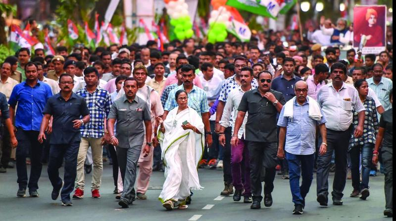 West Bengal chief minister and Trinamul Congress chief Mamata Banerjee takes part in a protest rally in Kolkata on Wednesday against the clashes that broke out during BJP president Amit Shah's election roadshow on Tuesday. (Photo: PTI)