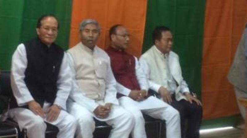 Four Congress Manipur MLAs including Y. Surchandra Singh and Ngamthang Haokip join BJP. (Photo: ANI/Twitter)