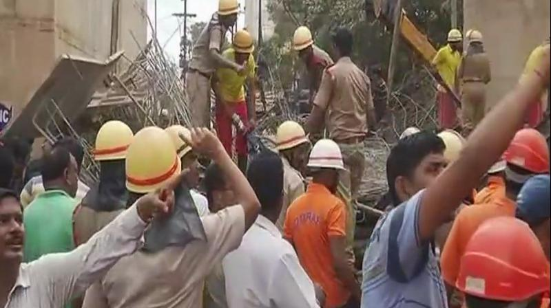 Rescue workers at site where the flyover collapsed in Bhubaneswar, Odisha. (Photo: Twitter | ANI)