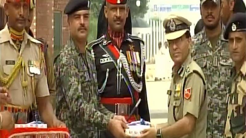 On the occasion of India's 71st Independence Day, sweets were exchanged at Wagah-Attari border on Tuesday, between BSF first line of defense and Pak Rangers. (Photo: ANI/Twitter)