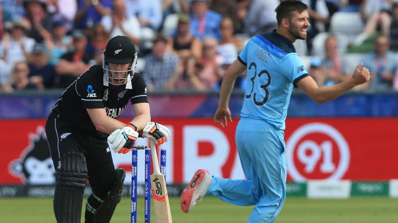 England fast bowler Mark Wood hopes his World Cup luck holds after his fortunate run out of New Zealand captain Kane Williamson helped take the hosts into the semi-finals. (Photo:AFP)