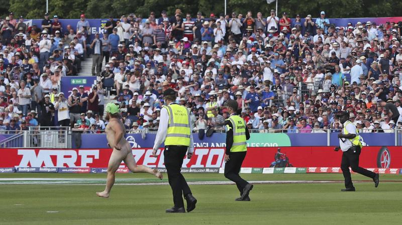 Stewards and security were extremely slow to react as the spectator halted play by jogging toward the middle of the field and dancing about in front of New Zealand batters Tom Latham and Mitchell Santner. (Photo:AP)