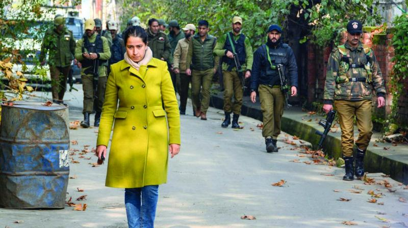 Shahriyar Khanam, daughter of incarcerated former minister and senior PDP leader Nayeem Akhtar, comes out of the government accomodation, where all former ministers, MLAs and mainstream political leaders are kept under detention, on the 108th day of strike in Srinagar on Wednesday. (Photo: PTI)