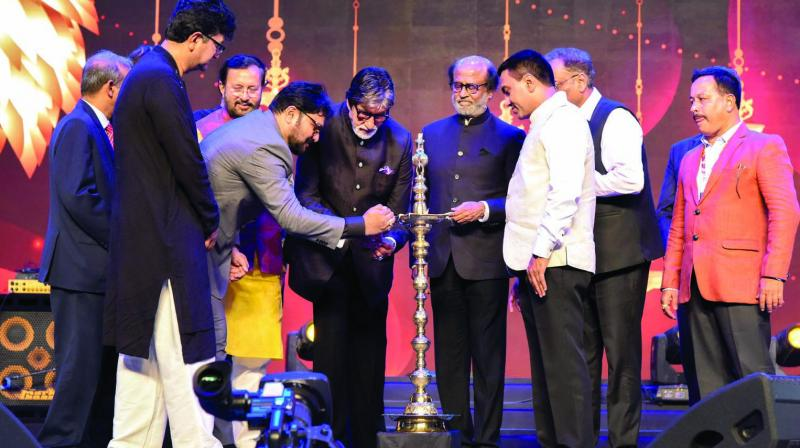 I&B minister Prakash Javadekar, superstars Amitabh Bachchan and Rajinikanth light the ceremonial lamp at the opening of the 50th edition of the Iffi. (Photo: PTI)