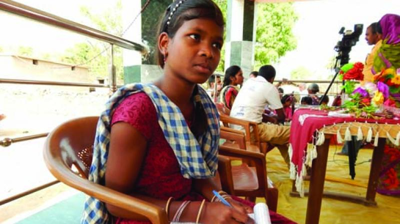 Sukanti Kalu, 14, sitting at at the village chaupal (public meeting place).