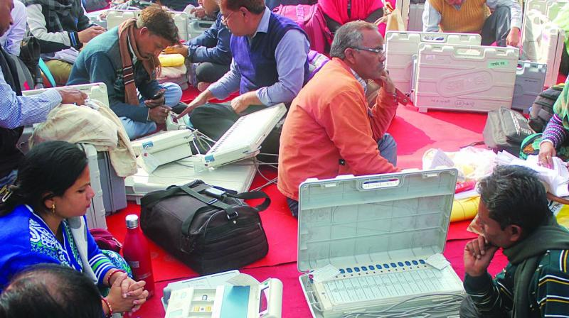 Polling officers collect EVMs before leaving for booth in Nagar Palika Election in Lucknow. (Photo: PTI)