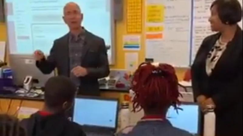 The student asked 'Who's Jeff Bezos?' twice, to another student sitting behind him. (Photo: Screengrab)