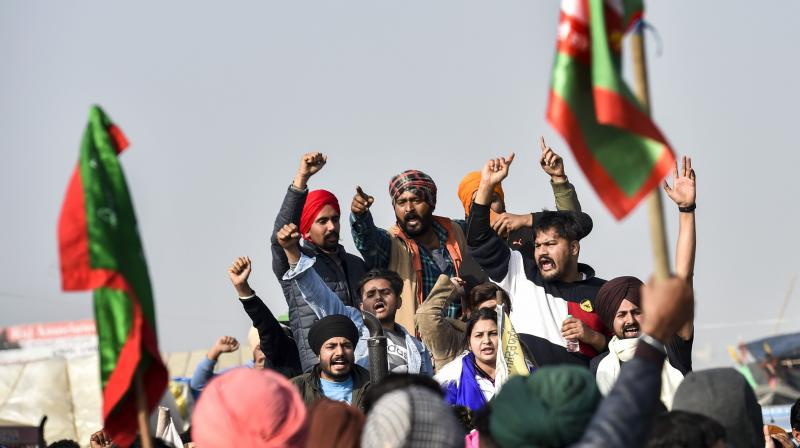 Farmers shout slogans during their protest against the new farm laws, at Singhu Border in New Delhi, Thursday, Dec. 17, 2020. (PTI)