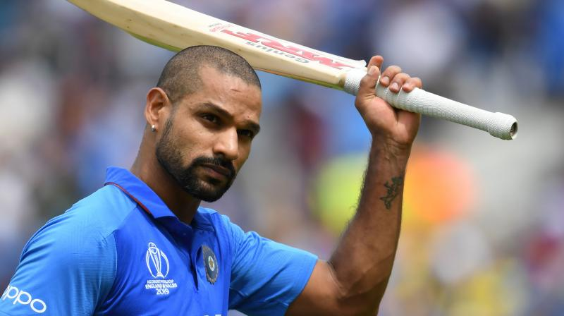 Dhawan and Sharma took the attack to the reigning champions' bowlers after a cautious start against the Australia new-ball pair of Pat Cummins and Mitchell Starc. (Photo: AFP)
