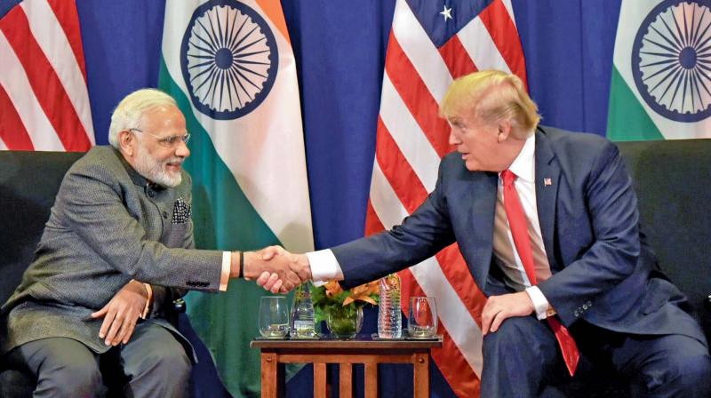 Prime Minister Narendra Modi shakes hand with US President Donald Trump during a bilateral meeting in Manila, Philippines. (Photo: PTI)