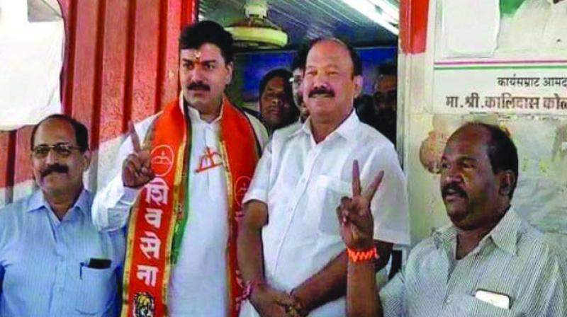 Mr Kolambkar seen with Shiv Sena's Rahul Shewale.