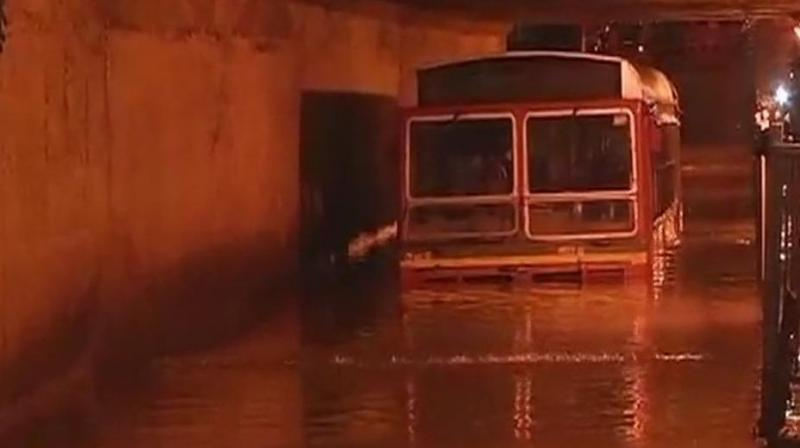 Since Tuesday, Mumbai is witnessing heavy rainfall accompanied by thunder and lightning which has led to water-logging in many areas. (Photo: ANI | Twitter)