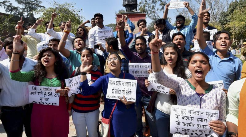 ABVP activists shout slogans as they hold a protest against AISA at DU campus in New Delhi. (Photo: AP)
