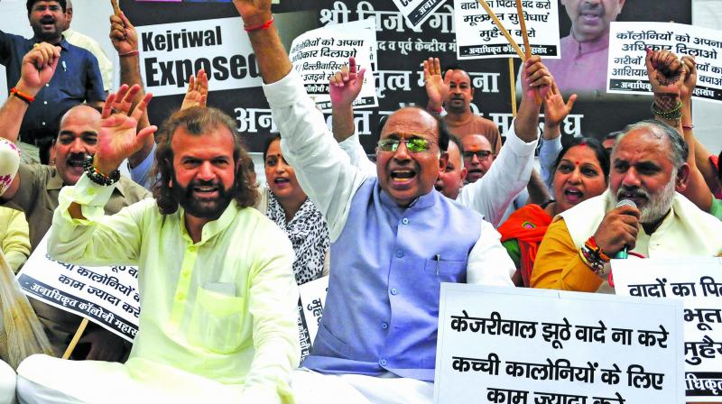 BJP leaders Vijay Goel and Hans Raj Hans protest against the Delhi government for allegedly delaying the regularisation of unauthorised colonies at Jantar Mantar in New Delhi on Thursday. (Photo: Bunny smith)