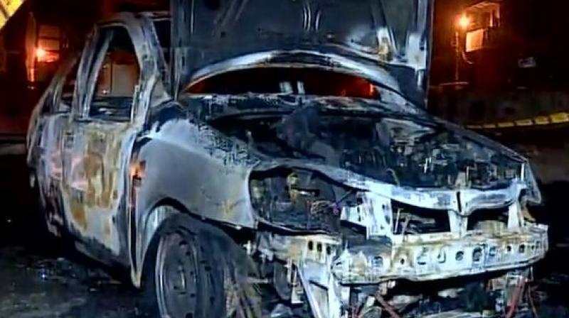 A man was killed after an Indigo car caught fire near Delhi's Mundka area. (Photo: ANI/Twitter)