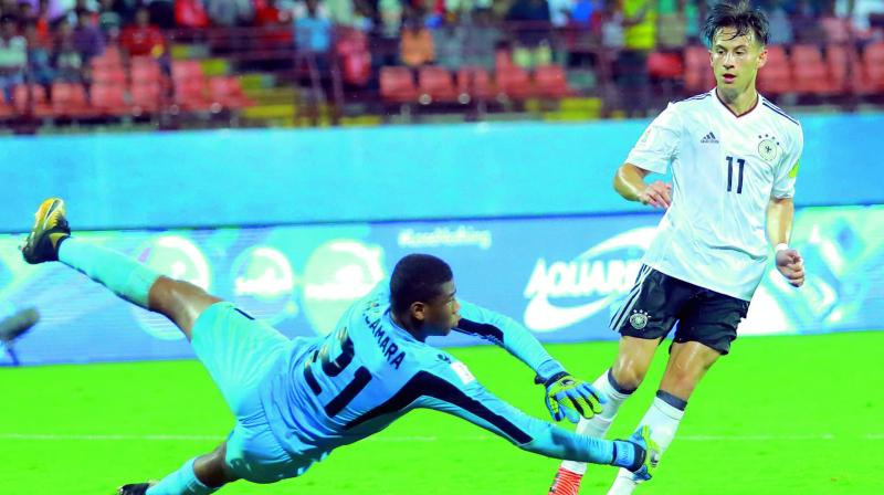 Germany's Nicolas Kuhn scores against Guinea in their Fifa U-17 World Cup Group C match at the Jawaharlal Nehru Stadium in Kochi on Friday. Germany won 3-1. (Photo: Arun Chandra Bose)