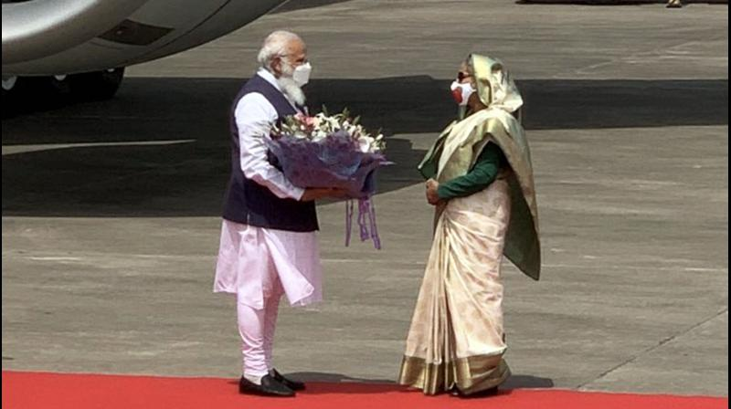 Prime Minister Narendra Modi being received by Bangladesh PM Sheikh Hasina, in Dhaka, Friday, March 26, 2021. (PTI)
