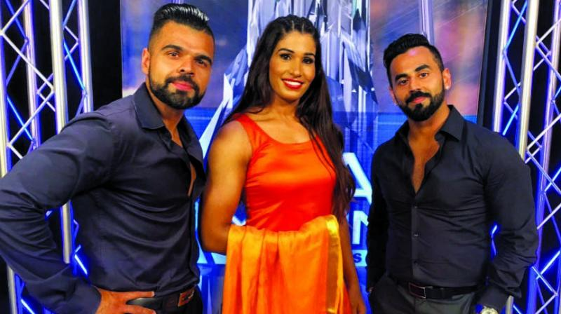 Kavita Devi (c) with The Singh Brothers, managers for WWE superstar Jinder Mahal.