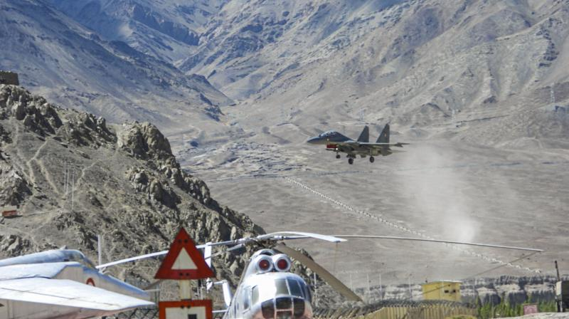 An IAF aircraft flies in the Ladakh region amid India-China border tensions. — PTI photo