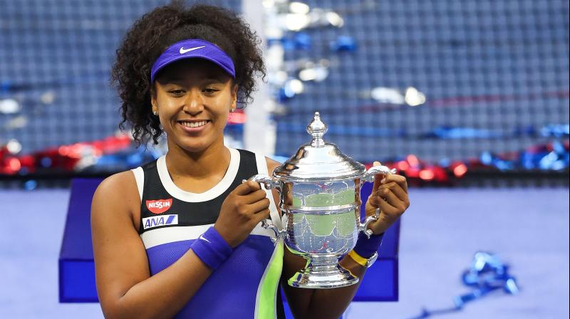 Japan's Naomi Osaka kisses the trophy in celebration after winning her Women's Singles final match against Victoria Azarenka of Belarus at the US Open in New York. — AFP photo
