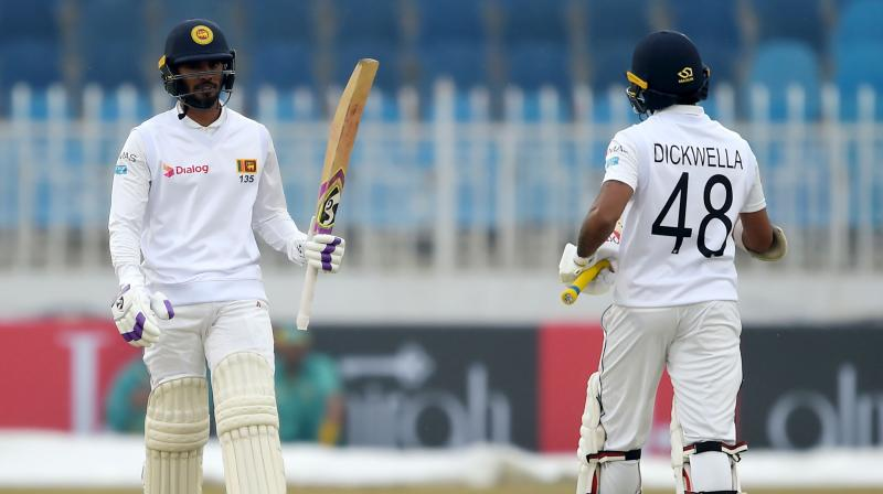 Before going out for the final day's play in the Rawalpindi Test, it was clearly in the mind of Sri Lanka captain Dimuth Karunratne to declare the innings immediately after Dhananjaya de Silva achieves his hundred in the rain affected match and he immediately did so at the completion of over. (Photo:AFP)