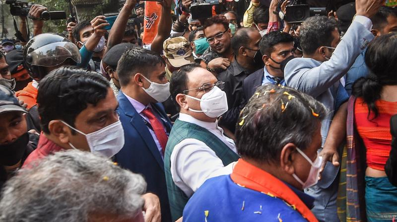 BJP National President JP Nadda is greeted by his party supporters on his arrival in Kolkata, Wednesday, Dec. 9, 2020. Nadda is on a two-day visit to West Bengal from today. (PTI)