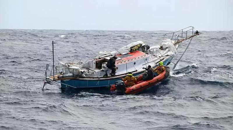 In this photo provided by the Australian Maritime Safety Authority, Indian sailor Abhilash Tomy, left, transfers to an inflatable boat as rescuers collect him from his damaged yacht, Thuriya, in the southern Indian Ocean. (Photo: AP)