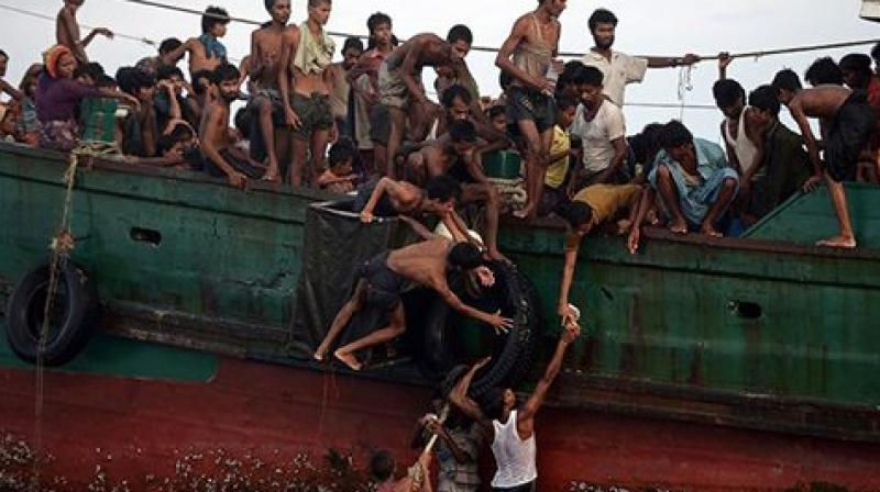 Myanmar has sent a list of more than 1,000 'wanted' alleged Rohingya militants to Bangladesh, while headshot photos of the suspects have been widely circulated inside the country. (Photo: AFP)
