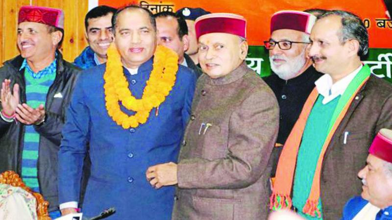 Himachal Pradesh CM Jai Ram Thakur being congratulated by former CM P.K. Dhumal on getting the top post.