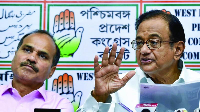 Senior Congress leader P Chidambaram interacts with the media as West Bengal Pradesh Congress president Adhir Chowdhury looks on, at Pradesh Congress office in Kolkata. (Photo: PTI)