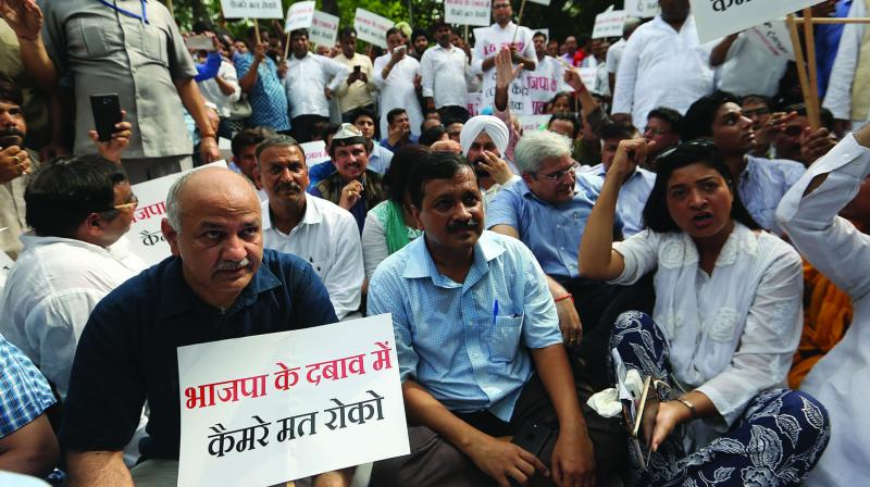 Delhi chief minister Arvind Kejriwal, deputy CM Manish Sisodia and party workers sit on a dharna outside lieutenant-governor Anil Baijal's house in New Delhi on Monday. (Photo: Biplab Banerjee)