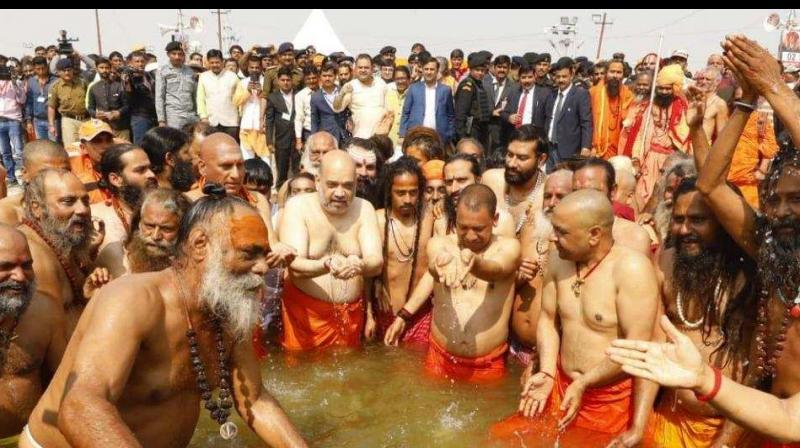 Wearing a saffron dhoti, the leaders of the BJP offered their prayers at Sangam, the holy confluence of the Ganges, Yamuna and the mythical Saraswati. (Photo: Amit Shah | Twitter)