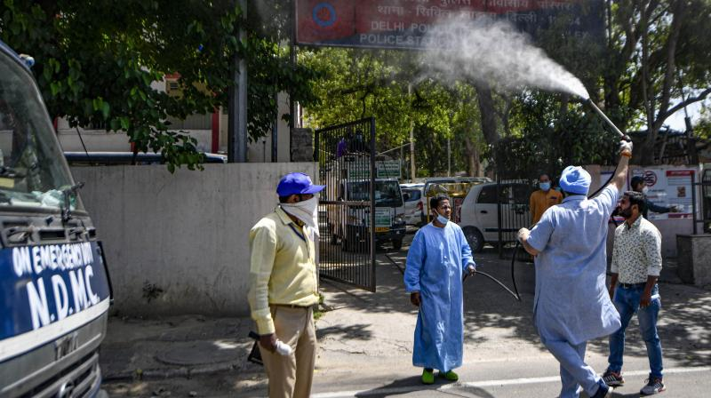 Mayor Avtar Singh along with North MCD workers sanitizes a locality in the Civil Lines area in the view of the coronavirus outbreak during the ongoing nationwide lockdown, in New Delhi. PTI photo