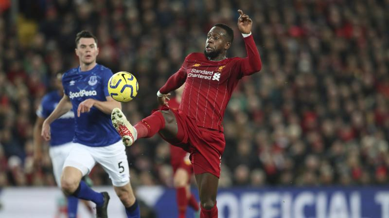 Liverpool delivered a first-half masterclass to humiliate Everton at Anfield on Wednesday, surging into a 4-2 halftime lead and adding a late fifth to maintain their charge towards a first league title in 30 years.  Rarely in that barren period, or even in the glory years that preceded it, could they have produced a better first half as exquisite passing and deadly finishing brought two goals for Divock Origi and one each for Xherdan Shaqiri and Sadio Mane. (Photo:AP)