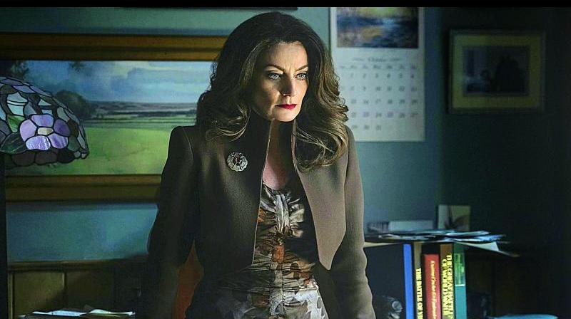 A still from the series Chilling Adventures of Sabrina where Mrs Wardwell is a teacher over the week, but lives in solitude during the weekend.