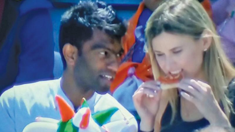 A picture of a white woman and an Indian man sitting alongside each other at the match has gone viral with n number of jokes.