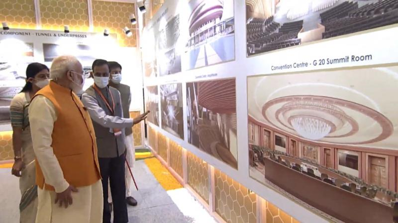 PM Modi reviewing the model of the new exhibition complex at Pragati Maidan. (Photo: Twitter)