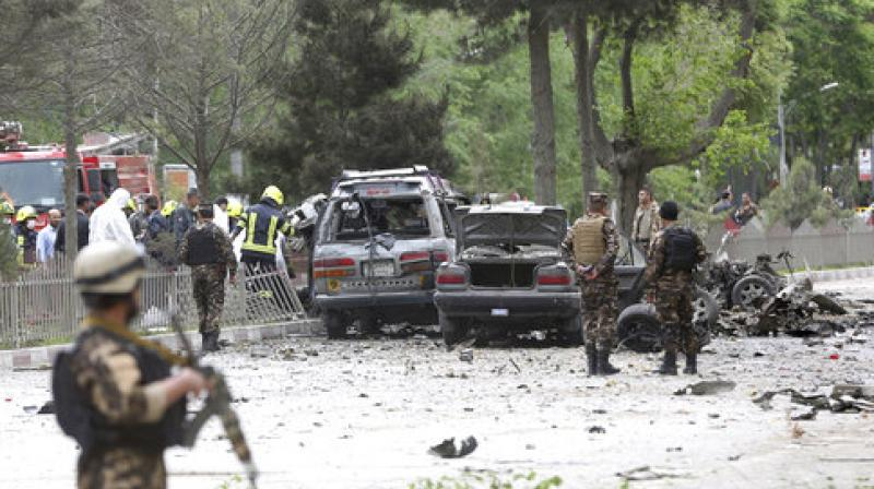 Security forces inspect at the site of a suicide attack in Kabul, Afghanistan. (Photo: AP)
