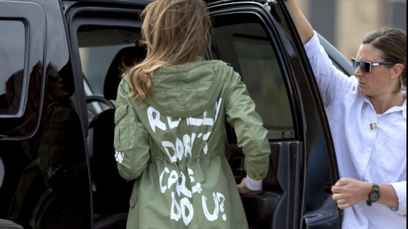 The military-style jacket with large white brush-style lettering is apparently sold for USD 39 at Zara. (Photo: AP)