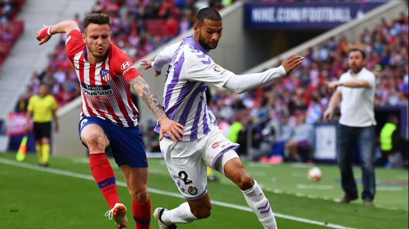 The game was decided by a glaring error from Valladolid defender Joaquin Fernandez, who appeared at the near post to try to clear a cross from Atletico's Saul Niguez but instead headed the ball straight into his own net. (Photo: AFP)