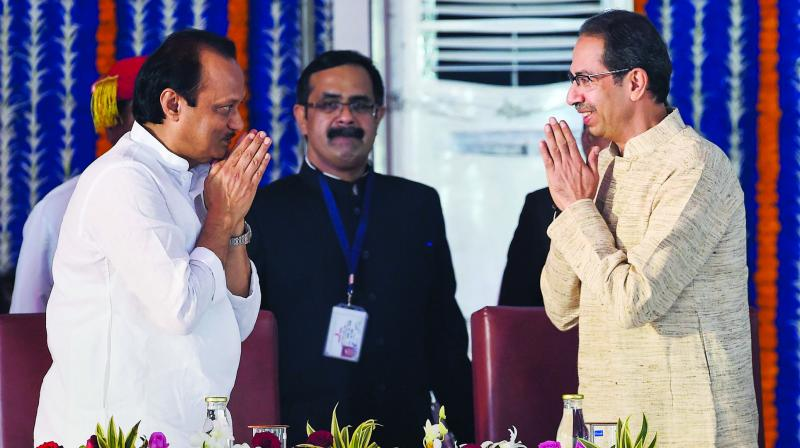 NCP leader Ajit Pawar being greeted by chief minister Uddhav Thackeray during the swearing-in ceremony for Maharashtra Cabinet expansion at Vidhan Bhavan in Mumbai. (Photo: PTI)