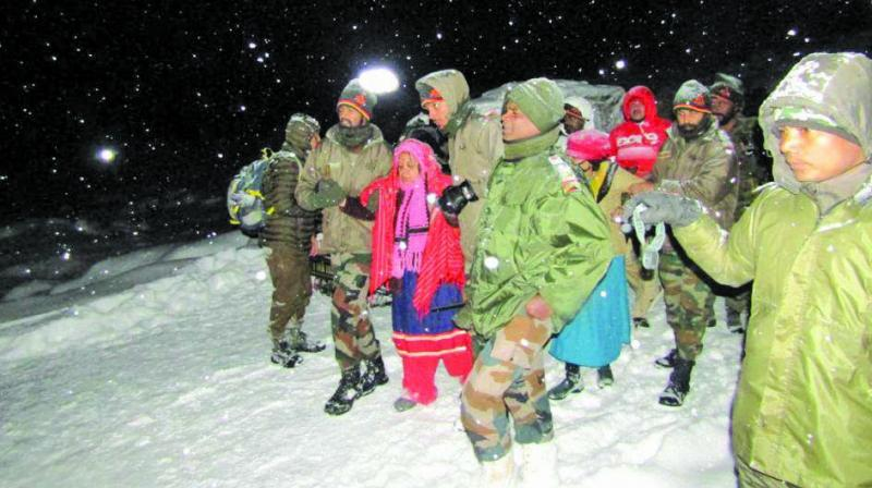 Stranded tourists being rescued by Army personnel in North Sikkim on Wednesday.