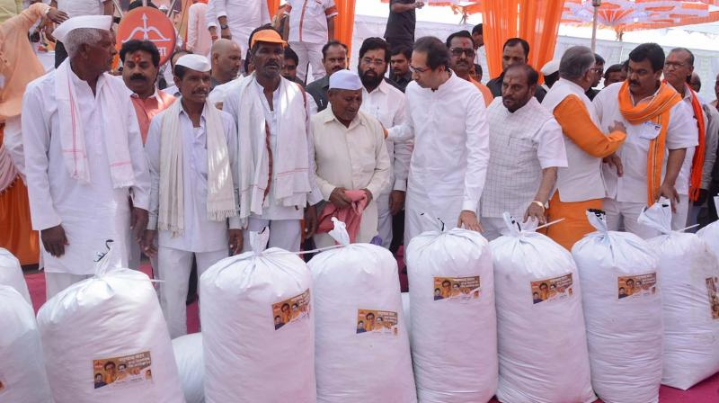 Shiv Sena chief hands over essential supplies during his visit in Beed district, Marathwada on Wednesday.