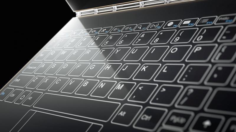 The patent shows Apple's intention to use an OLED panel for the keyboard panel whereas the other half remains the same like conventional laptops. (Representative Image)