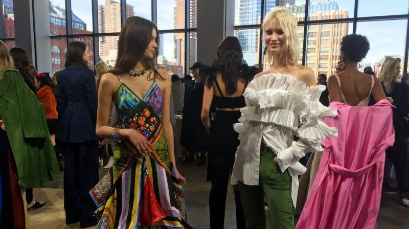 From plaids, coats to a milieu of colours, New York Fashion Week sees designers bringing out their best. (Photos: AP)