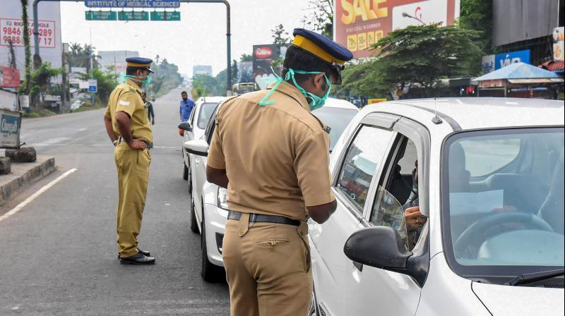 Police stop vehicles during the ongoing coronavirus lockdown in Kerala. The state reported its first death due to the virus on March 28, 2020. (PTI)