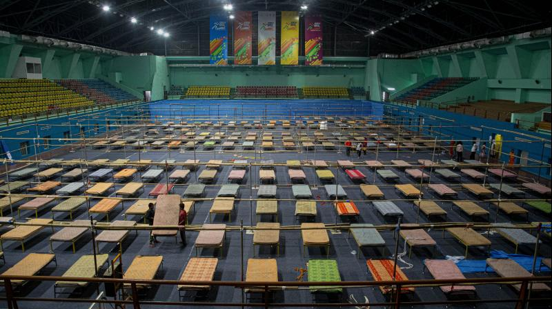 Workers prepare a quarantine centre at the Sarusojai Sports Complex in Guwahati on March 28, 2020. (AP)