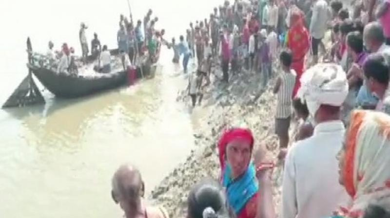 Around 100 people were on board when the boat capsized in the river Ganga. (Photo/ANI)