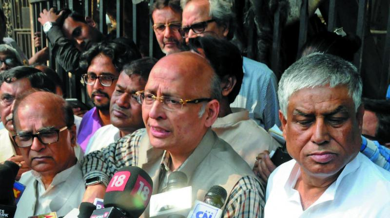 TMC-supported Congress-nominated RS candidate Abhishek Manu Singvi along with RS MP Pradip Bhattacharjee and the Leader of the Opposition Abdul Mannan at a press meet outside the Assembly in Kolkata on Thursday. (Photo: Asian Age)