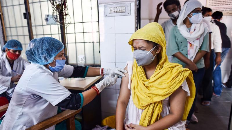A medic administers a COVID-19 vaccine at Tej Bahadur Sapru Hospital in Prayagraj. (Photo: PTI)